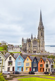 Cathedral  and colored houses in Cobh, Ireland - 208042456