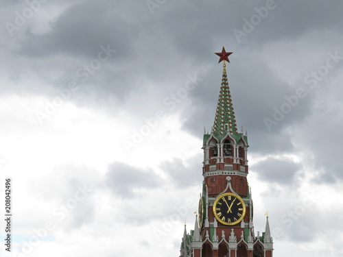 Fotobehang Moskou Spasskaya tower of the Moscow Kremlin against of dramatic dark sky. Kremlin Red star and chimes, tourist landmark on Red square