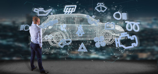 Businessman in front of a wall with car icon on a futuristic interface