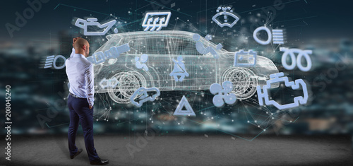Fototapeta Businessman in front of a wall with car icon on a futuristic interface