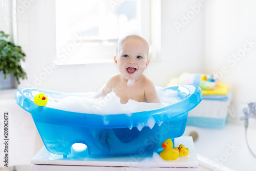 Little baby taking a bath - 208063672
