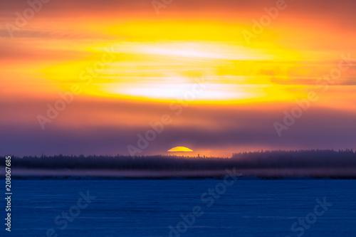 Fotobehang Zee zonsondergang Sunrise from Sotkamo, Finland.