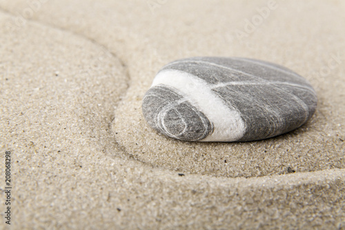 Aluminium Zen stones on sand for relaxation as background