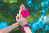 woman hands with flower in yoga mudra gesture outdoor in nature closeup summer day - 208068877