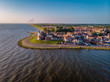 Urk Netherlands a small village alongside the lake ijsselmeer Netherlands with the colorful lighthouse - 208070870