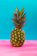 Pineapple in front of blue background - 208089416