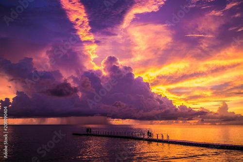 Fotobehang Zee zonsondergang Khao Lak sunset on the beach in Thailand