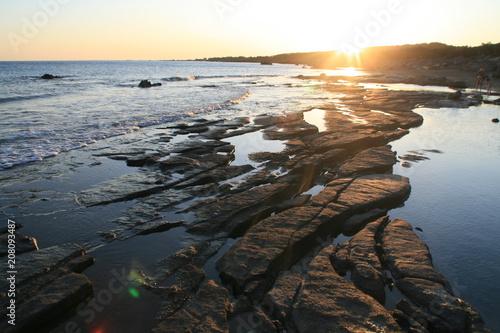Fotobehang Zee zonsondergang View of a beach at sunset, Crete, Greece