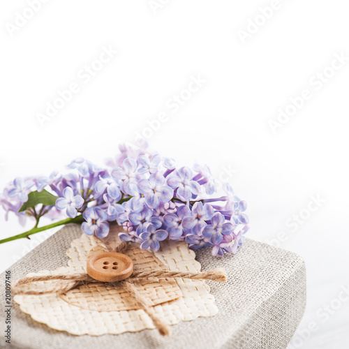 Lilac flowers with gift box