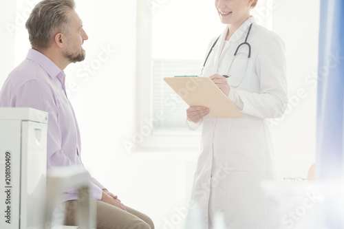 Professional doctor and sick man - 208100409