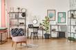 Pink armchair in workspace interior