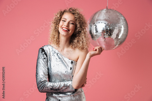 Portrait of a smiling beautiful woman in shiny dress