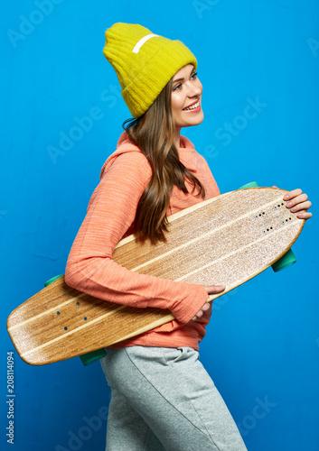 Fotobehang Skateboard Girl holding wooden skateboard, longboard.