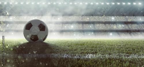 Fußball liegt auf Stadionrasen im Rauch