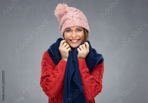 Foto Murales Smiling woman wearing knitted sweater, winter scarf and cup.