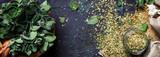 Dried ground oregano or marjoram, dark background, top view - 208119630