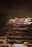 Homemade chocolate cake with nuts, rustic background, selective focus - 208124452