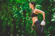 Leinwanddruck Bild - Beautiful sportswoman stretching leg in the park. Morning exercise concept.