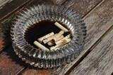 Wet used cigarettes in a glass ashtray. This image can be used to represent smoking or bad habits.  - 208127823