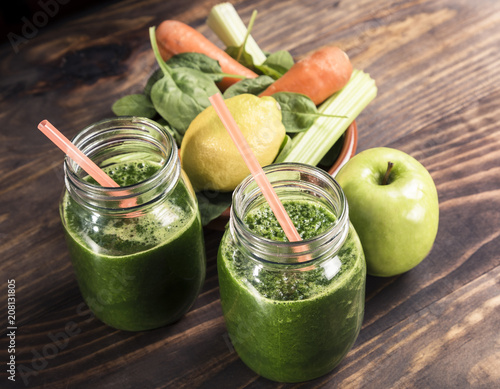 Aluminium Sap Spinach with apple and vegetables juice a soft drink jar with straw on wooden table