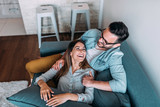Top view of couple relaxing on sofa. - 208132414