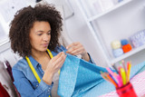 seamstress sews clothes workplace of tailor - 208132655