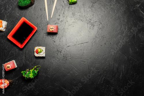 Aluminium Sushi bar Top view of Japanese Sushi and chopsticks on black background. Sushi rolls, nigiri, maki, pickled ginger, wasabi, soy sauce. Space for text. Top view. Sushi background. food frame
