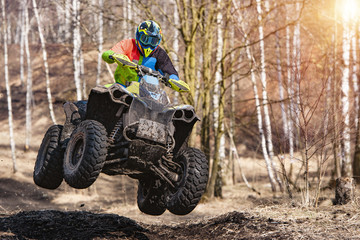 ATV Rider jump in the forest