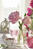 fruit tea in beautiful  porcelain cup and peony flowers