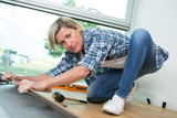 removing the old flooring - 208148827