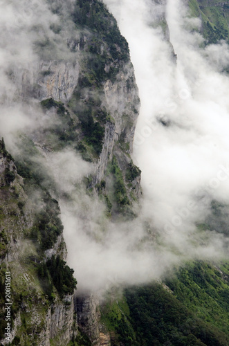 Fotobehang Zwart in den Wolken