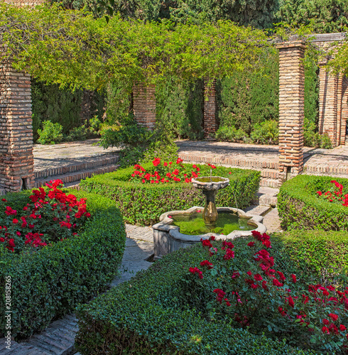 Garden with flowers in the Alcazaba of Malaga, Spain