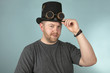 Smiling man in a top hat looking ahead