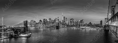 Brooklyn, Brooklyn park, Brooklyn Bridge, Janes Carousel and Lower Manhattan skyline at night seen from Manhattan bridge, New York city, USA. Black and white wide angle panoramic image. - 208170490