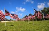 Patriotic display of multiple large American flags - 208180082