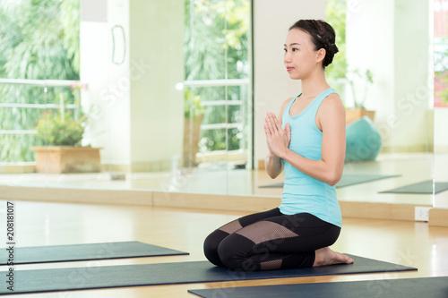 Fotobehang School de yoga Young asian women practicing yoga meditation, healthy lifestyle, wellness, well being