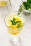 Detox water fitness healthy nutrition diet concept Fresh lemon mint detox drink glass white wooden table