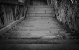 Black and white stairs going down with a lot grafiti - 208200259