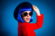 Leinwanddruck Bild - Sale! Portrait of excited impressed girl in eyewear red elegant outfit headwear with open mouth isolated on blue background