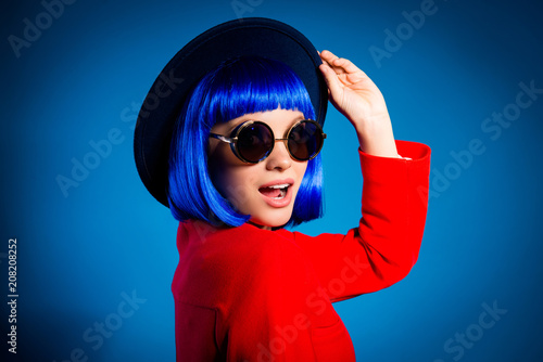 Leinwanddruck Bild Sale! Portrait of excited impressed girl in eyewear red elegant outfit headwear with open mouth isolated on blue background