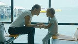 Young mother and little daughter waiting a voyage at seaport lounge. - 208213075