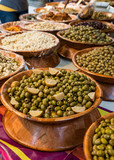 Olives stand in French open air market - Green olives with lemon slices
