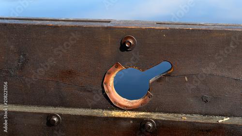 Fotobehang Schip Leather clad oar hole on a wooden Viking ship replica.
