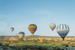 scenic view of colorful hot air balloons flying over valley of Cappadocia, Turkey