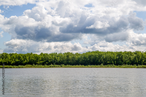large cumulus clouds on the river - 208228648