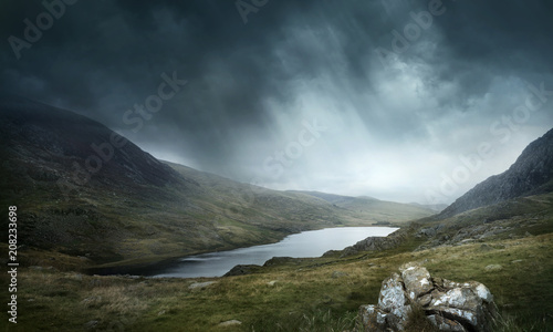 A place of myths and legends. Wild weather and terrain make for good adventures. Mountains and lakes landscape. Photo composite.