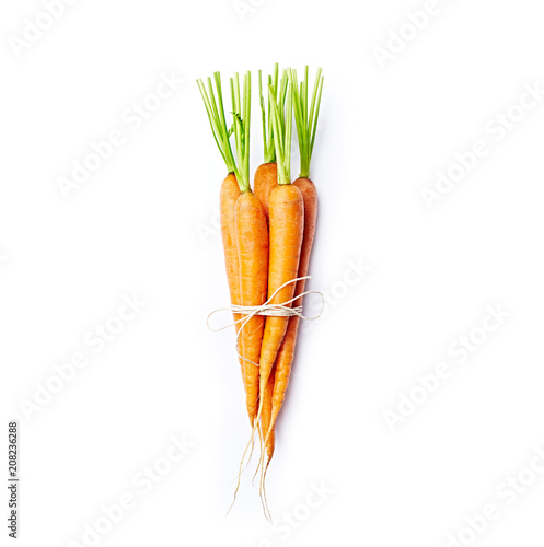Bunch of fresh organic carrots on white background; flat lay