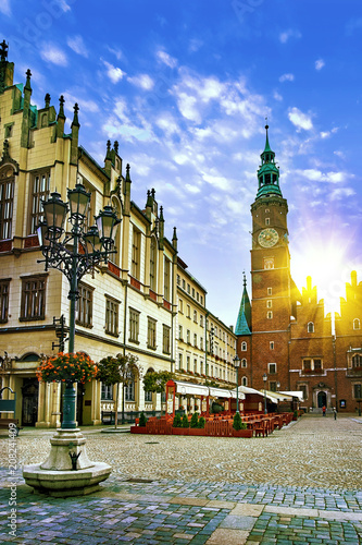 Leinwanddruck Bild Wroclaw Market Square with Town Hall and street lantern lamp against stunning sunset sky. Evening sunlight in historical capital of Silesia Poland, Europe. Travel vacation concept