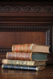 old books piled on an old furniture - 208241860