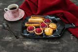 Mixed dessert Raspberry tartlet, Eclair Puffs, almond lemon - 208246438